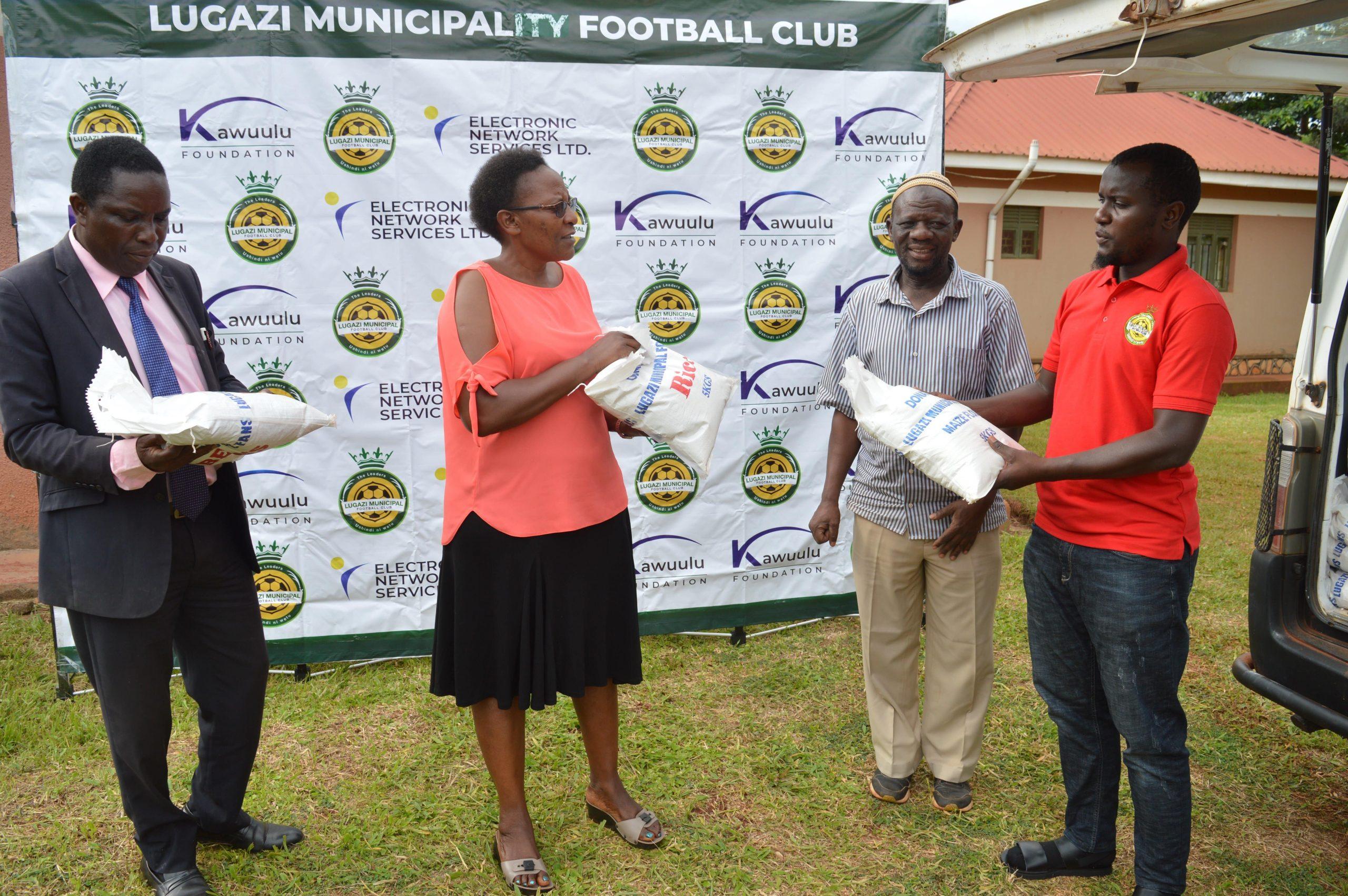 LUGAZI MUNICIPAL FOOTBALL CLUB FANS DONATE FOOD TO THE PLAYERS.